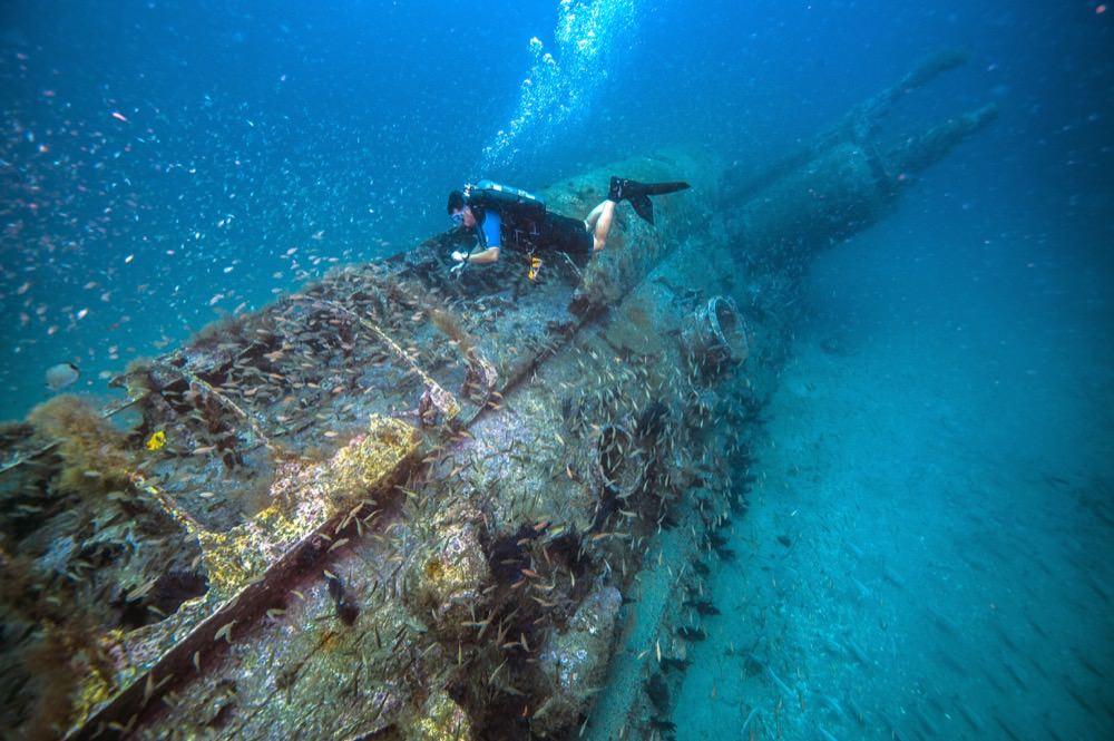 NOAA diver surveys the German U-boat, U-352.