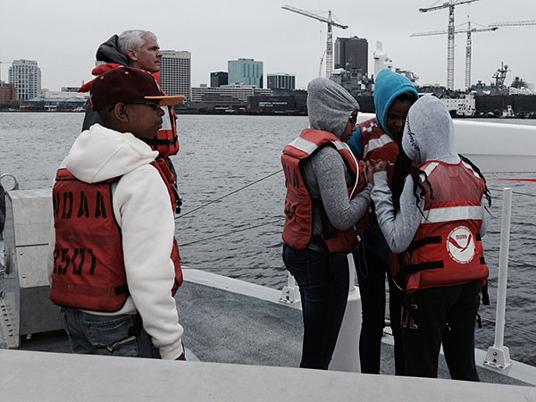 image of students on a boat