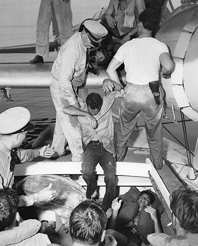 Survivors being pulled out of their raft